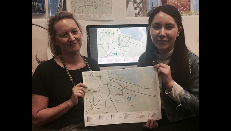 Gilimbaa's Amanda Lear and Tarni O'Shea with one of their Lendlease creative projects
